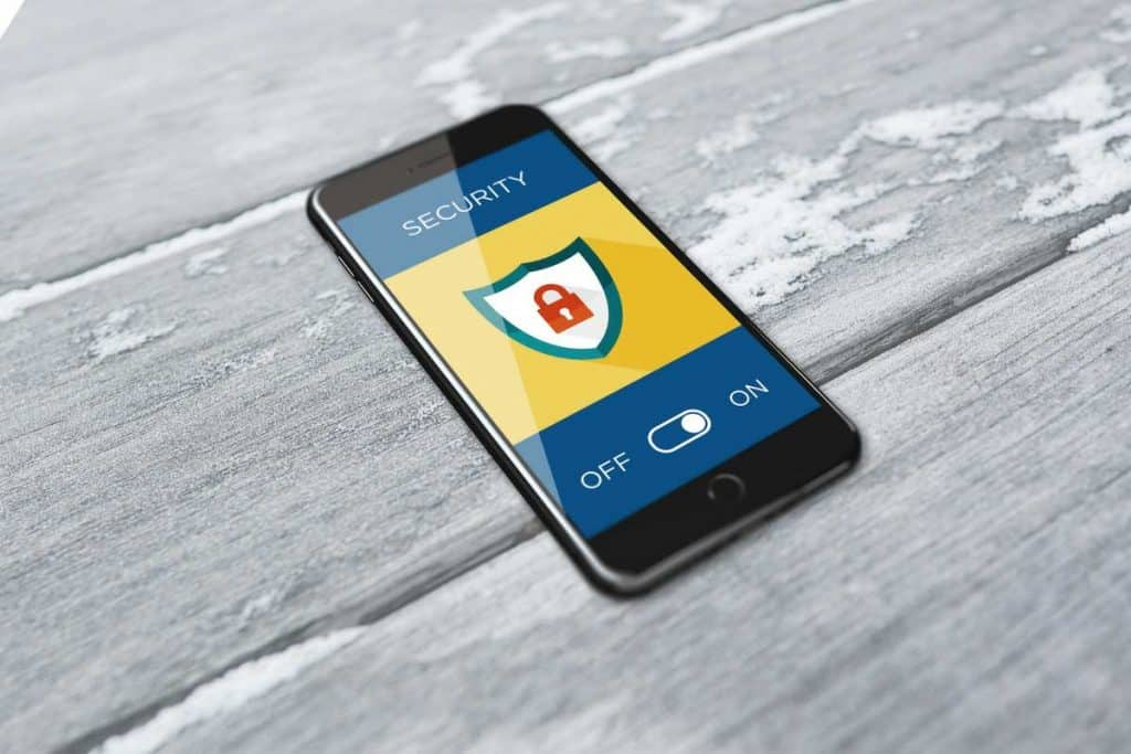 mobile phone showing hacked website security
