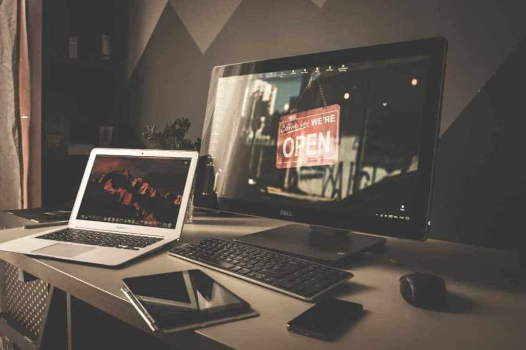 Desktop with business website as screen