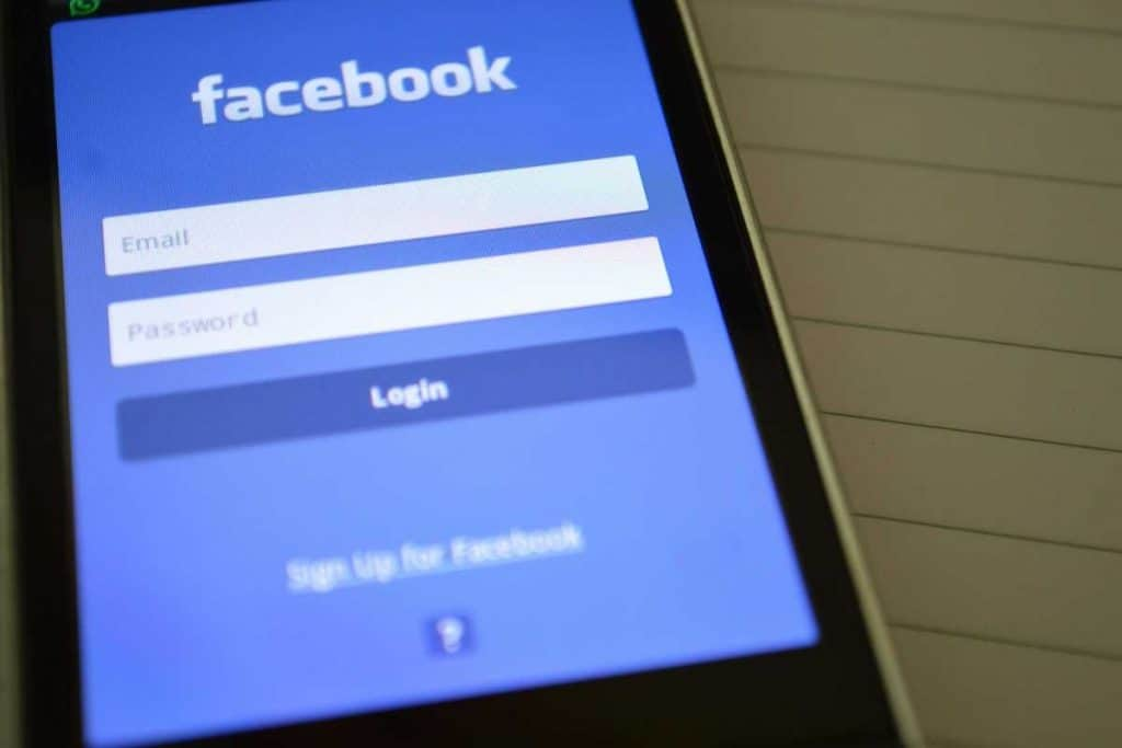 Close up screen of mobile with Facebook
