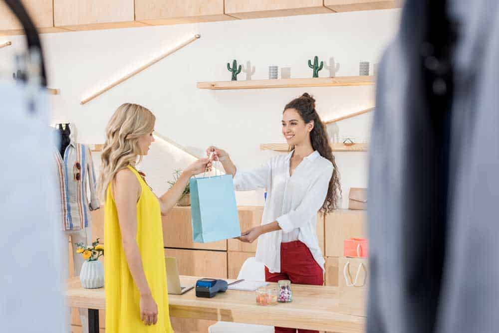 cashier giving customer her goods