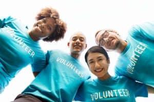 nonprofit volunteers huddling together