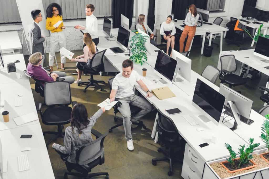 employees working in a coworking office to cut business costs