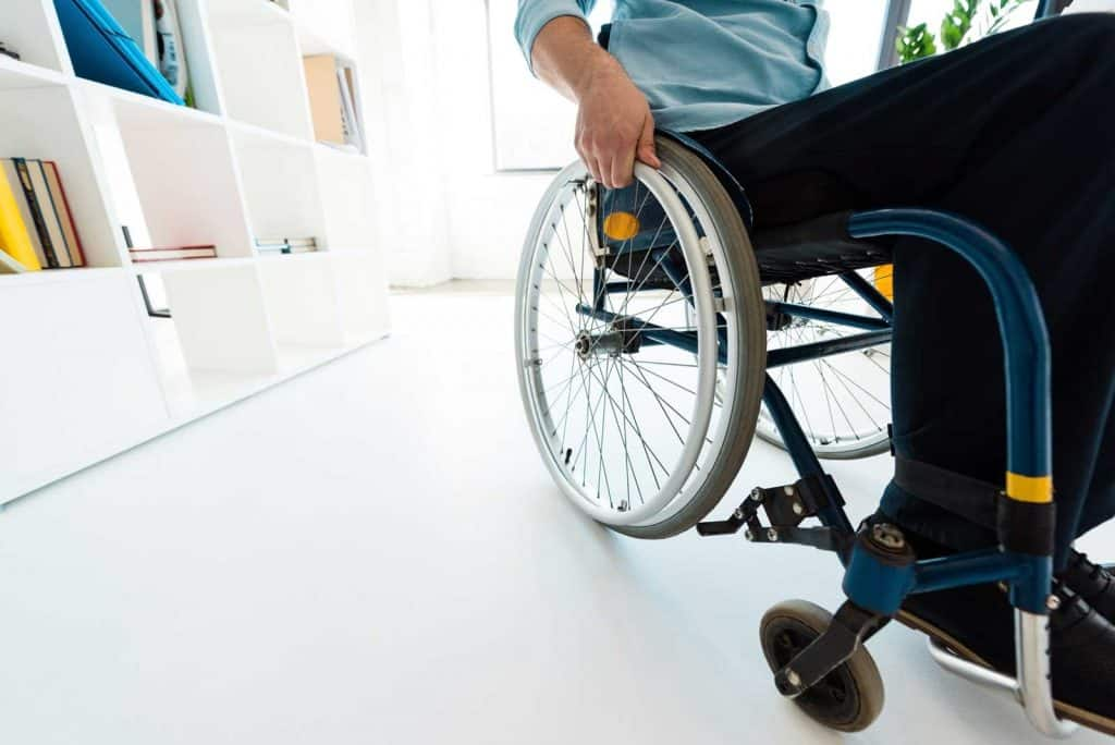man in a wheelchair in an office Workplace for PWDs