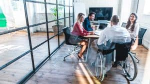 man in wheelchair in a business meeting