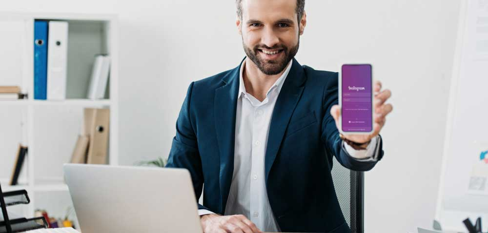 man showing phone with Instagram Shopping app on