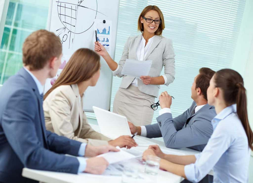 woman discussing financial outlook with team
