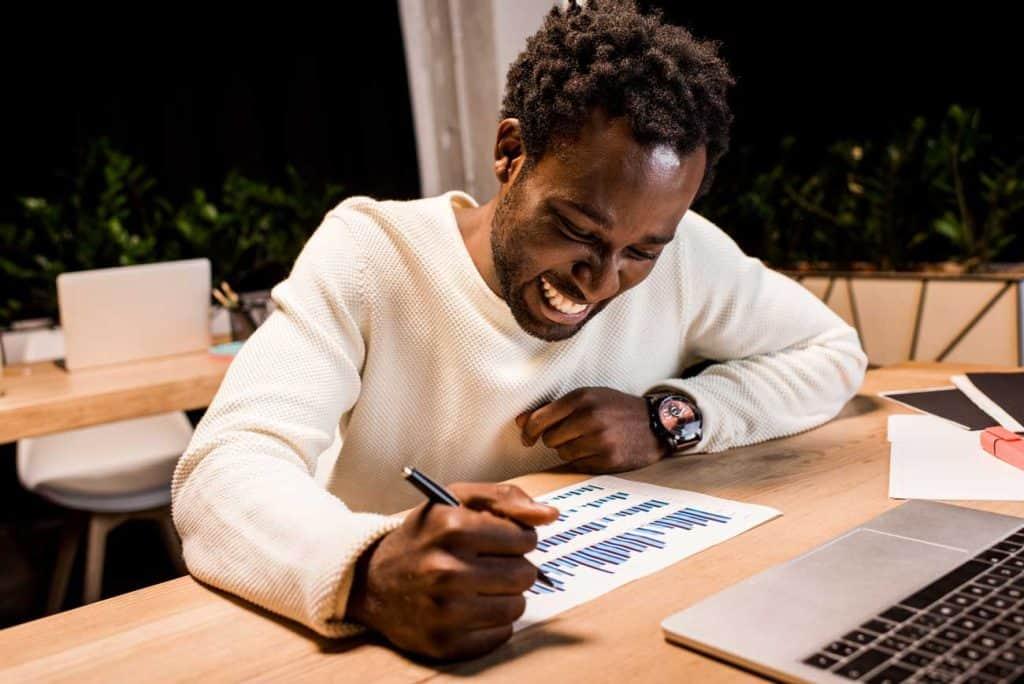 man writing down business ideas