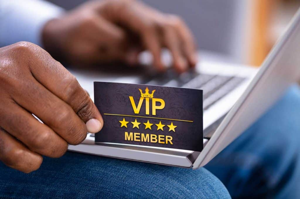 person holding a VIP card as loyalty marketing offer