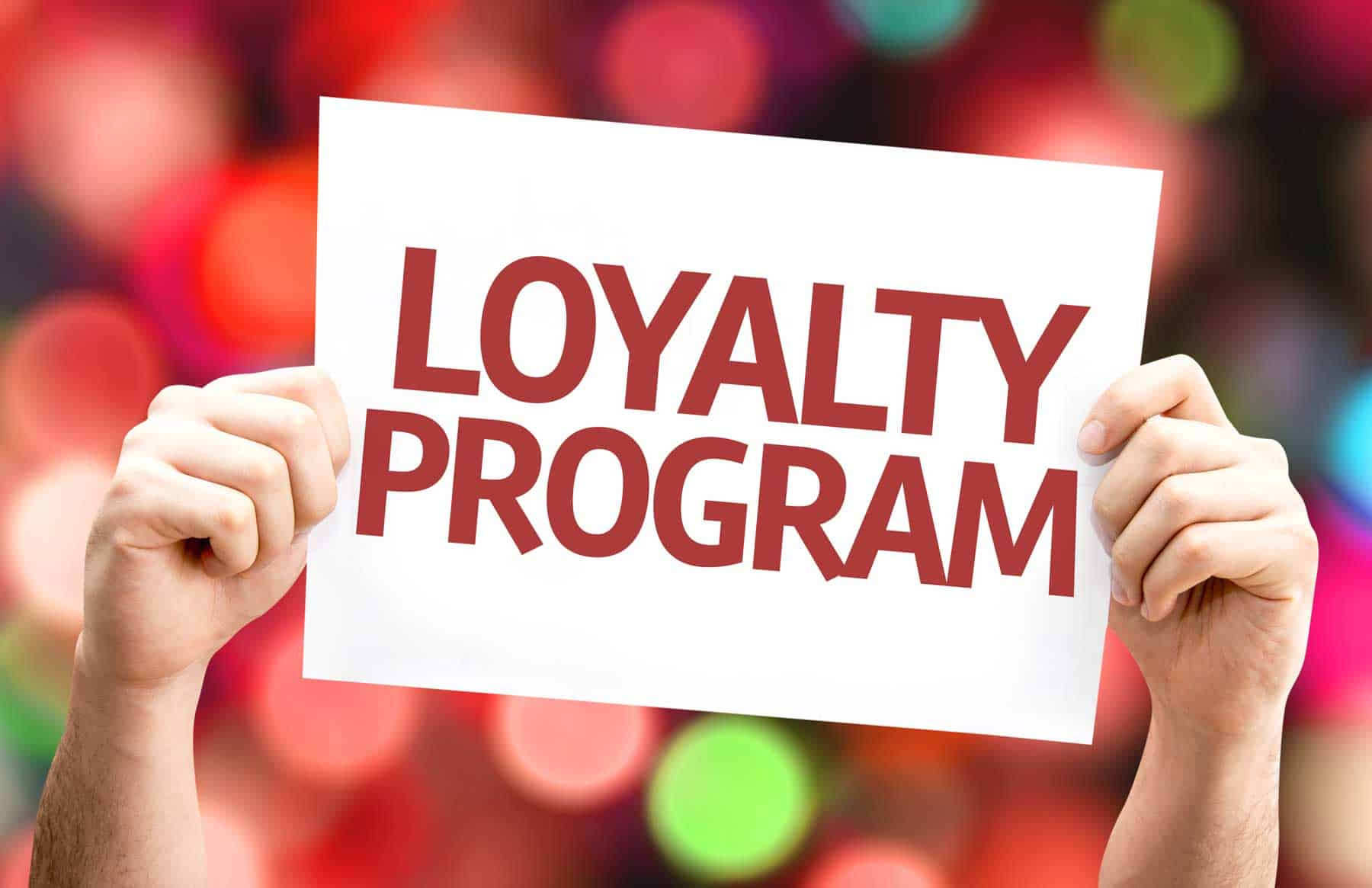 person holding loyalty marketing card